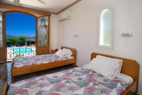 A bed or beds in a room at Nikos Studios and Apartments