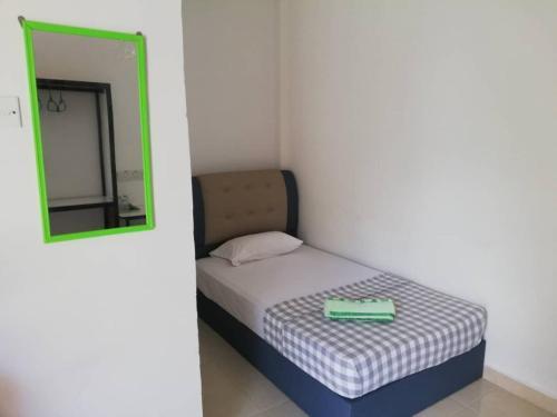 A bed or beds in a room at D Bohor Villa