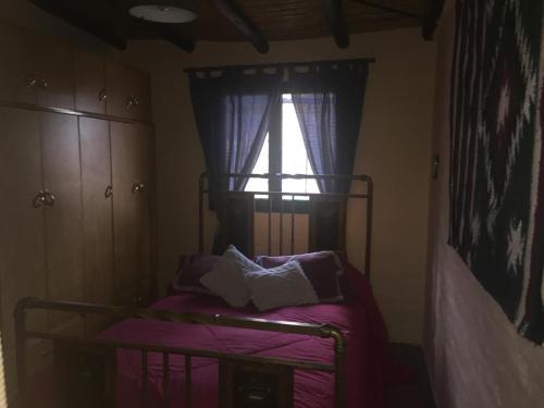 A bed or beds in a room at Casa en Chacras de Coria