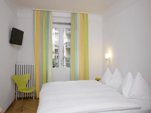 Ein Bett oder Betten in einem Zimmer der Unterkunft Hotel Marthahaus