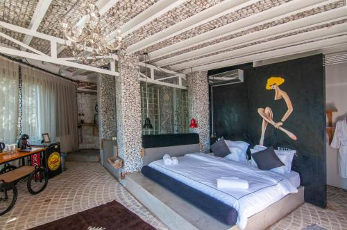 A bed or beds in a room at Ölüdeniz Loft - Adults Only