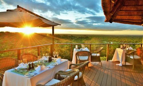 A restaurant or other place to eat at Victoria Falls Safari Club