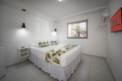 Cama ou camas em um quarto em Mar e Mar Florianópolis