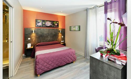 Un ou plusieurs lits dans un hébergement de l'établissement Hôtel Concorde - Rodez Centre Ville