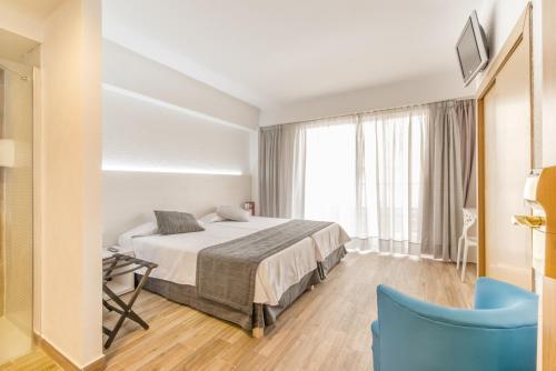Säng eller sängar i ett rum på Hotel Amic Horizonte