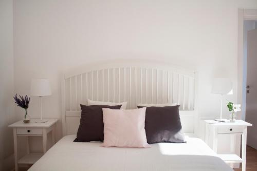 A bed or beds in a room at The Marvila - Modern 3 Bedroom Apartment in trendy New Lisbon