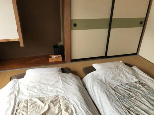 ゲストハウス・ イトカワにあるベッド