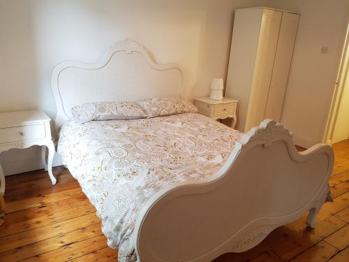 A bed or beds in a room at 504 Wilmslow Road