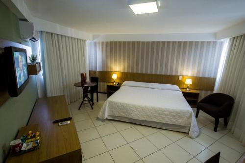 Cama ou camas em um quarto em Garbos Trade Hotel