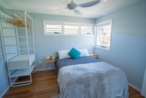 A bed or beds in a room at Tuffy's No. 2, 16B May Street, Crescent Head
