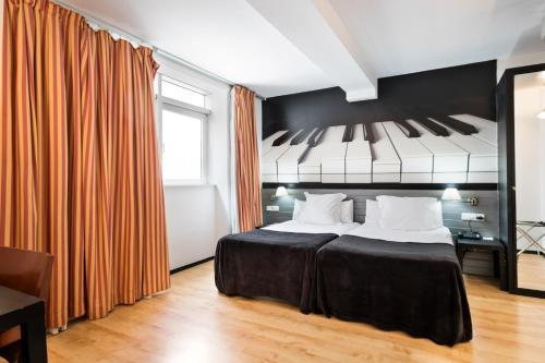 Кровать или кровати в номере Abba Jazz Hotel Vitoria