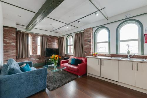 A kitchen or kitchenette at Base Serviced Apartments - Sir Thomas Street