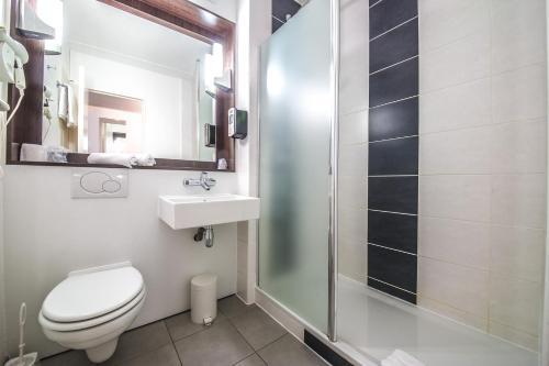 Ein Badezimmer in der Unterkunft Mandarina Hotel Luxembourg Airport