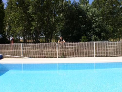 The swimming pool at or near Hotel Santa Coloma del Camino