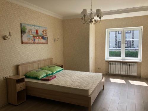 Кровать или кровати в номере Отдых на берегу озера