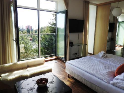 Posteľ alebo postele v izbe v ubytovaní Oliver - apartmán 16A