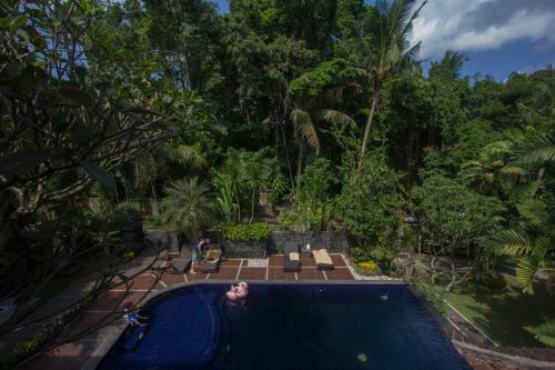 A view of the pool at Dewangga Ubud or nearby