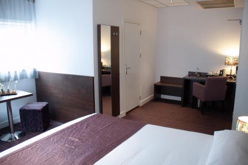 Ein Bett oder Betten in einem Zimmer der Unterkunft Hotel Luxer