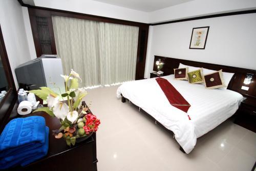Кровать или кровати в номере First Residence Hotel