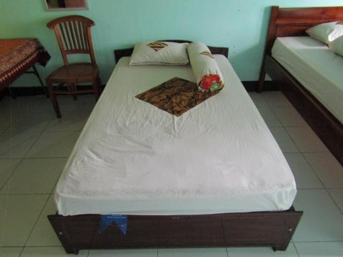 A bed or beds in a room at Renata Homestay