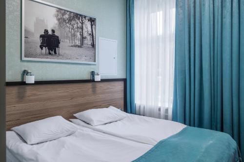 Кровать или кровати в номере СпбВергаз