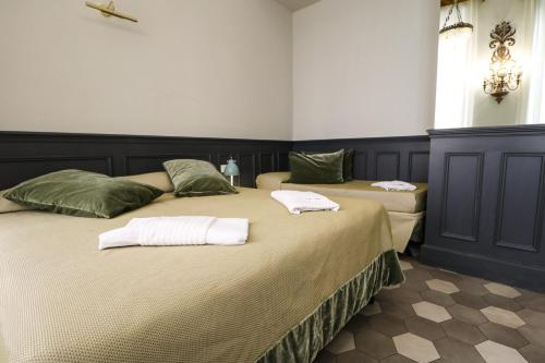 A bed or beds in a room at Residenza Ki