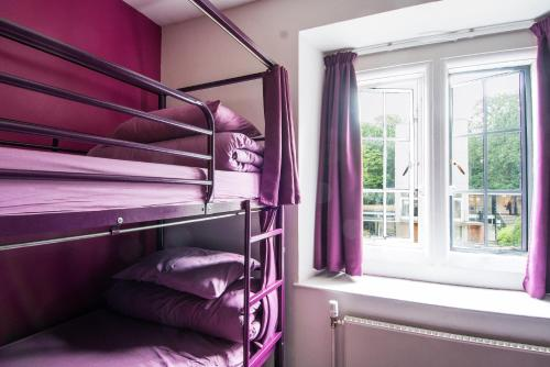 A bunk bed or bunk beds in a room at Safestay London Kensington Holland Park