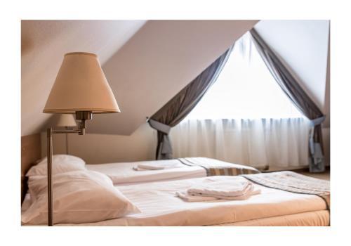 Кровать или кровати в номере Hotel Promenada