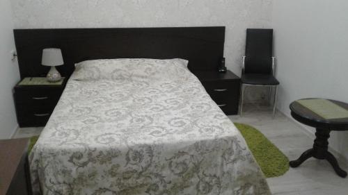 Кровать или кровати в номере Гостевой Дом Михалыч