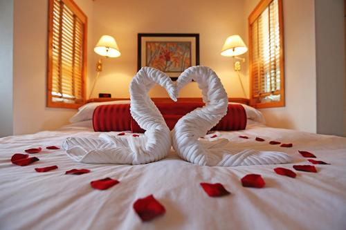A bed or beds in a room at Beaujolais Boutique B&B at Thea's House