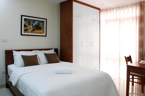 A bed or beds in a room at ISTAY Hotel Apartment 2