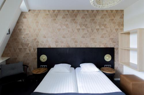 A bed or beds in a room at Boutique Hotel View