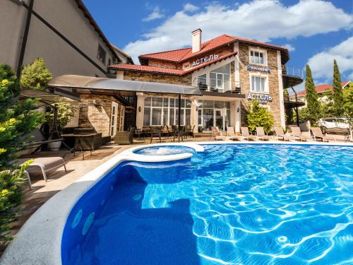 The swimming pool at or close to Astel Villa