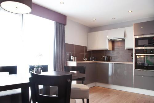 A kitchen or kitchenette at EPIC Apart Hotel - Duke Street