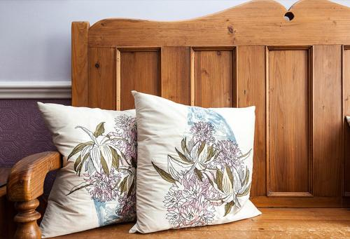 A bed or beds in a room at Gable End Guest House