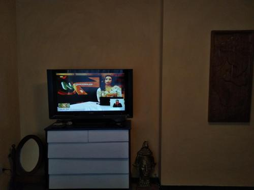 A television and/or entertainment center at Family Room - Habitación Familiar