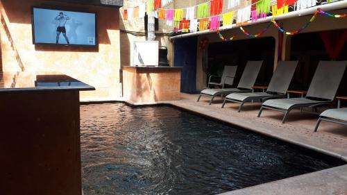 The swimming pool at or close to Hotel Mercurio - Gay Friendly