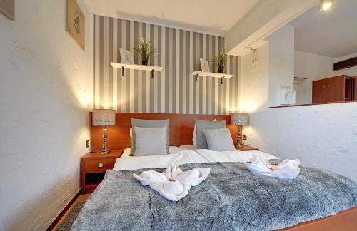 Łóżko lub łóżka w pokoju w obiekcie Pensjonat Safir