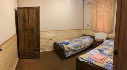 Кровать или кровати в номере Русский Двор