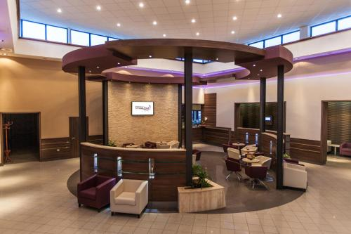 The lobby or reception area at Premium Hotel Panoráma