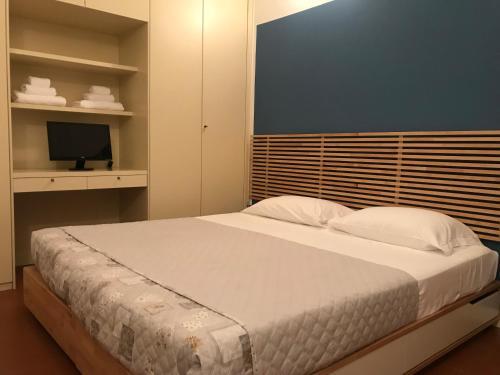 Letto o letti in una camera di Villa Donatella