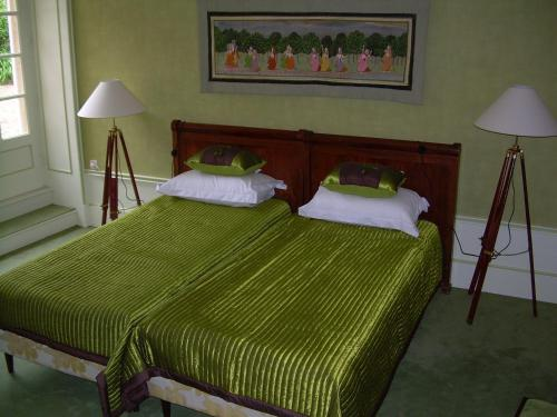 A bed or beds in a room at La Chipotte