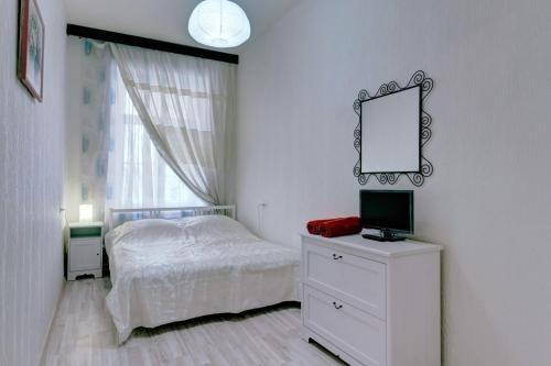 Кровать или кровати в номере СТН Апартаменты на канале Грибоедова