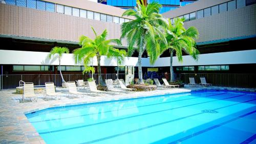 The swimming pool at or near Aston at the Executive Centre Hotel