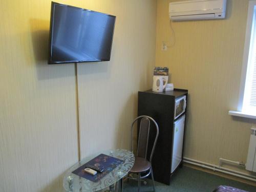 Телевизор и/или развлекательный центр в Гостиница Швеция