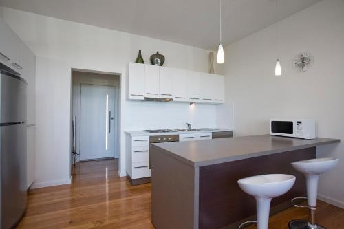 A kitchen or kitchenette at Exclusive Anglesea River Beach Apartment