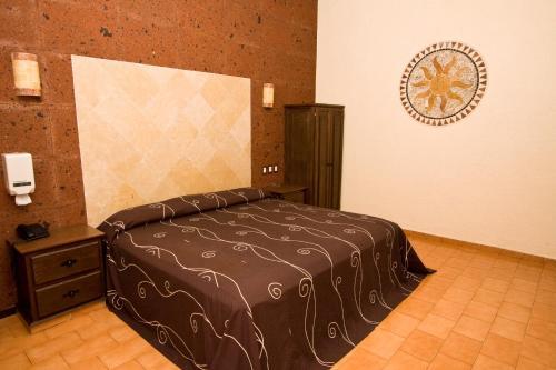 Cama o camas de una habitación en Hotel & Motel Hacienda Jiutepec