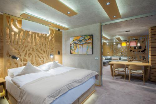 A bed or beds in a room at Wellness Hotel Step