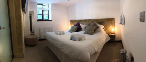 A bed or beds in a room at The Wiremill Sleep Boutique