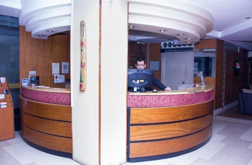 Лобби или стойка регистрации в San Remo City Hotel